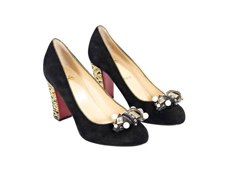906cc16ac41 Product details  Black suede Tudor Trott pumps by Christian Louboutin.  Embellished bow at vamp