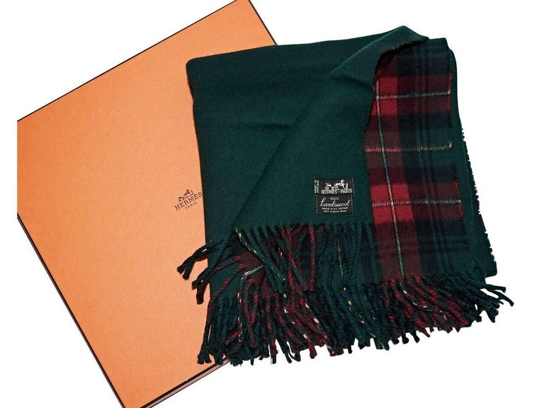 Product details:  Vintage green and red plaid lambswool scarf by Hermes.  Fringe trim.  Original box included.  Condition: Pre-owned. Very good. Est. Retail $ 1,500.00