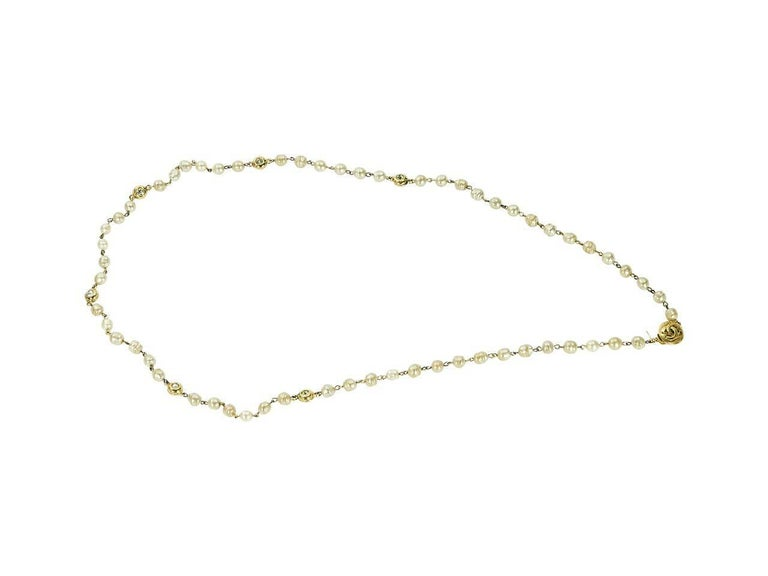 Product details:  Vintage goldtone faux pearl necklace by Chanel.  Single strand design that can be wrapped.  Accented with logo and crystal charms.  36