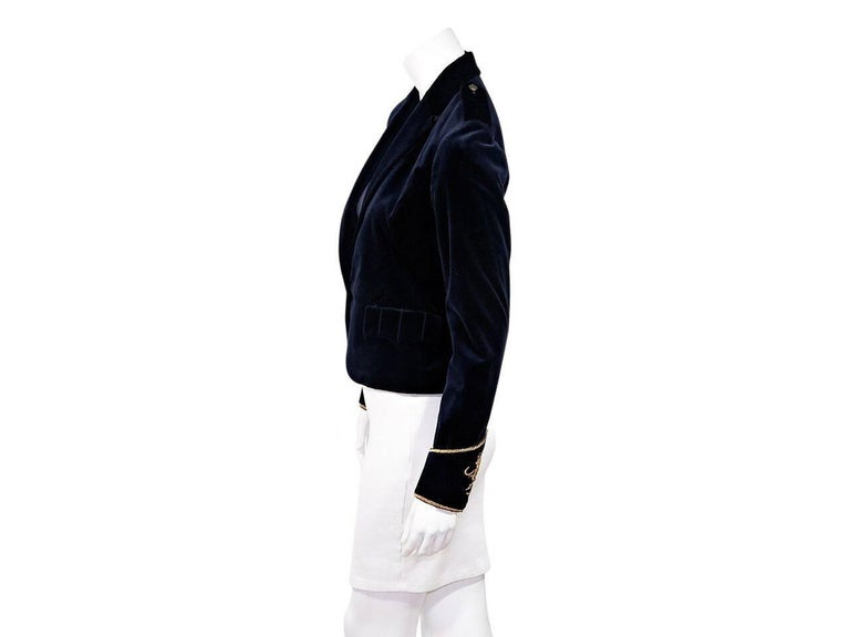 Product details:  Navy blue velvet blazer by Ralph Lauren.  Shoulder epaulettes.  Notched lapel.  Long sleeves.  Embroidered and embellished metallic gold cuffs.  Single button closure.  Flap waist pockets.   Condition: Pre-owned. Very good. Est.