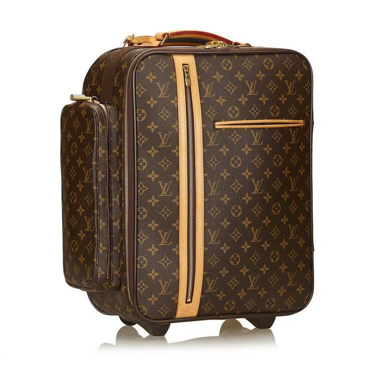 Product details:  Brown monogram canvas Bosphore 50 trolley suitcase by Louis Vuitton.  Trimmed with leather.  Top carry handle.  Zip-around closure.  Lined interior.  Front exterior slide and zip pockets.  Side exterior zip pocket.  Trolley wheels.