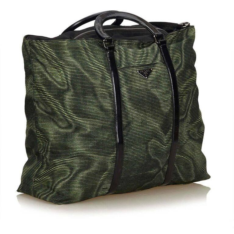 3f7ffb31470 Product details: Green nylon tote bag by Prada. Trimmed with black leather.  Top