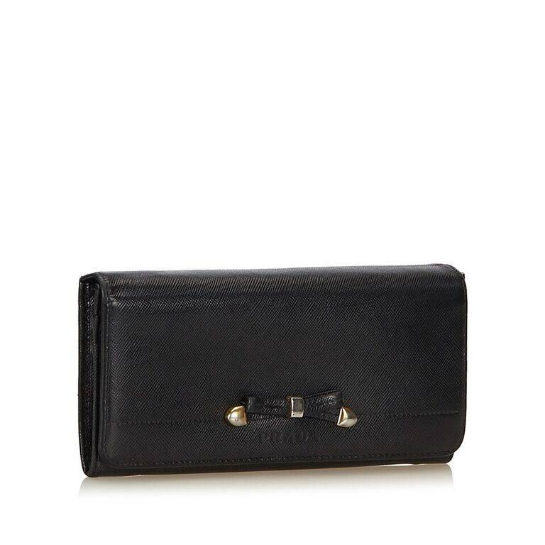 69133e7851a1 germany prada saffiano foldover snap wallet 3a827 d5e39; new arrivals  product details black saffiano leather long wallet by prada. bow detail  accents front