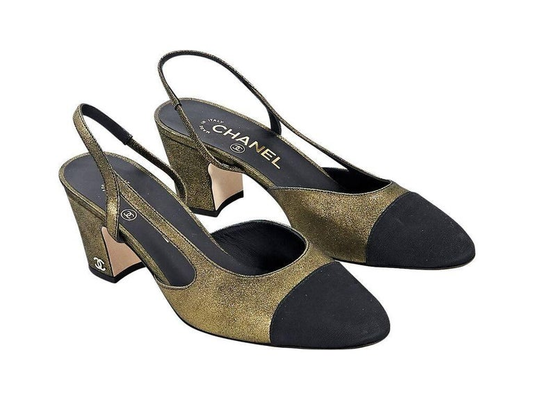 1a80e54b786 Product details  Metallic gold leather Mademoiselle kitten heels by Chanel.  Slingback strap with inset