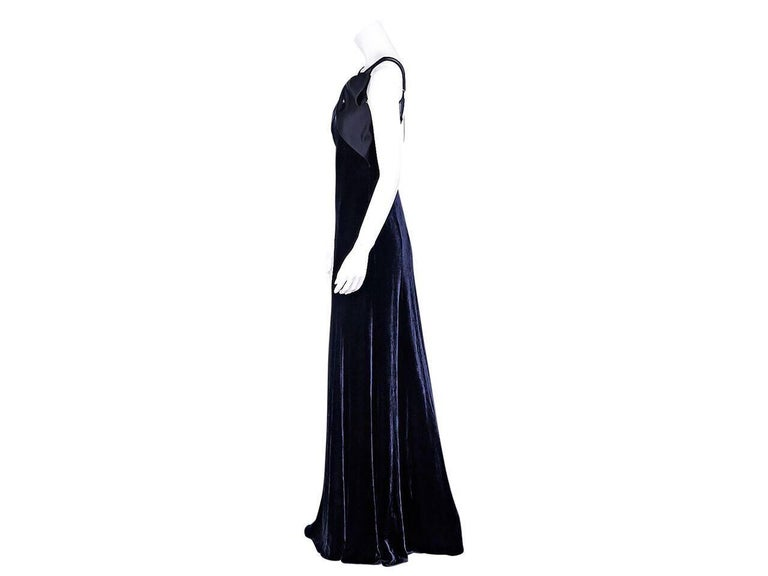 Product details:  Navy blue velvet gown by Armani Collezioni.  Wide boatneck.  Sleeveless.  Draped bodice detail.  Scoopback.  Concealed back zip closure.   Condition: Pre-owned. New with tags. Est. Retail $ 1,495.00