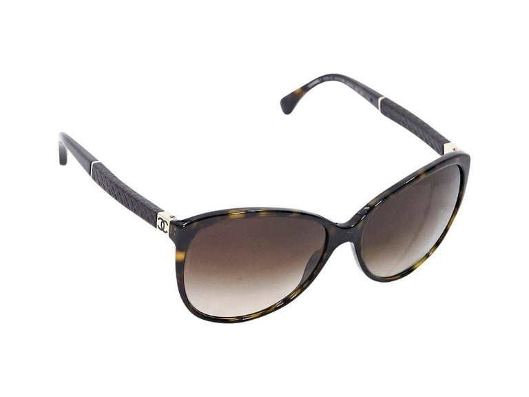 Product details:  Brown tortoiseshell cateye sunglasses by Chanel.  Gradient lenses.  Quilted detail at stems.  Goldtone hardware. Condition: Pre-owned. Very good. Est. Retail $ 738.00