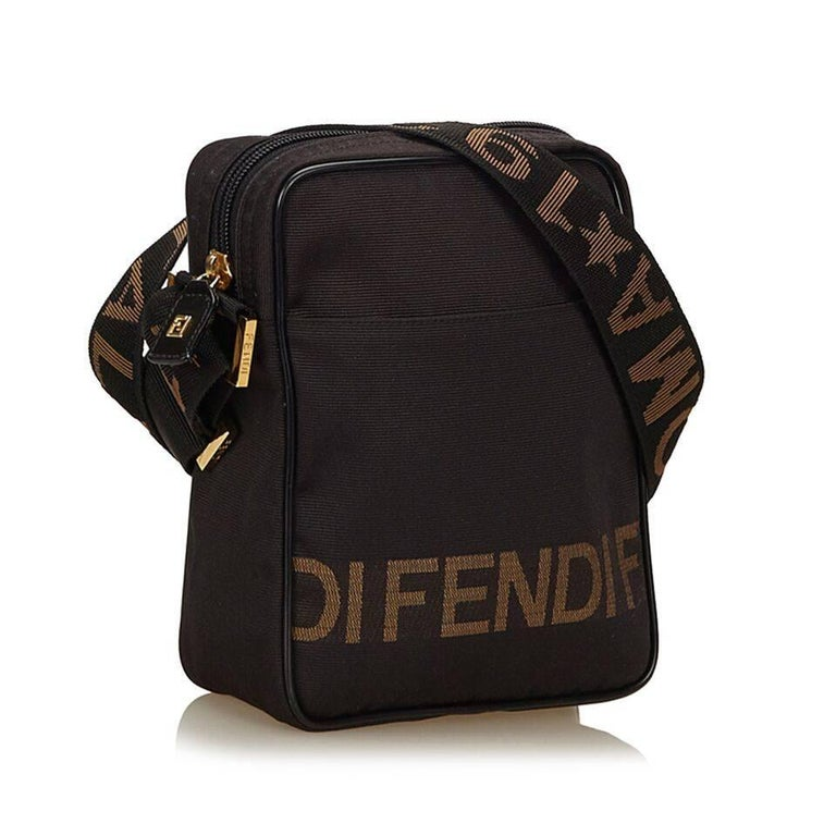 "Product details:  Brown nylon crossbody bag by Fendi.  Top zip closure.  Lined interior with attached zip pouch.  Front exterior slide pocket.  Goldtone hardware.  7""L x 9""H x 3""D. Condition: Pre-owned. Very good. Item is slightly out"