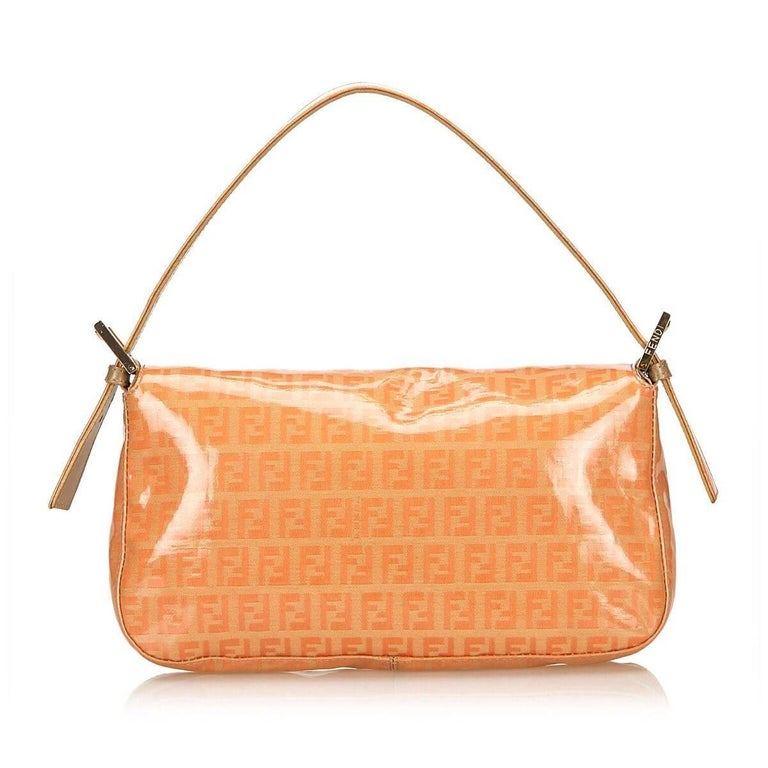 Product details:  Orange coated canvas Zucchino Mama baguette bag by Fendi.  Single shoulder strap.  Front flap with magnetic snap closure.  Lined interior with inner zip pocket.  Silvertone hardware.  Dust bag included.  10 6 2  Condition: