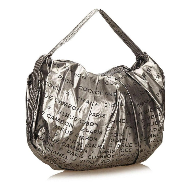 fb1cd605b02a Product details: Silver nylon Unlimited shoulder bag by Chanel. Single  shoulder strap. Top