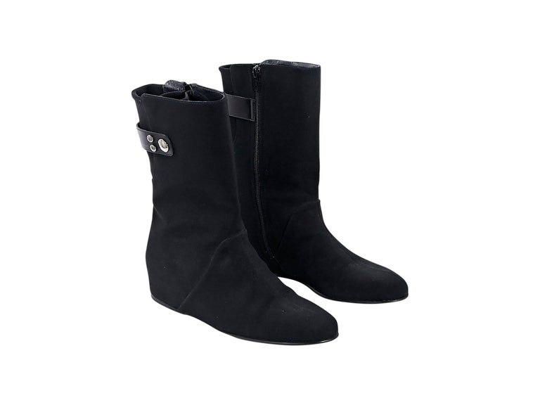 Product details:  Black wedge ankle boots by Stuart Weitzman.  Shaft strap accent.  Round toe.  Inner zip closure.   Condition: Pre-owned. Very good. Est. Retail $398