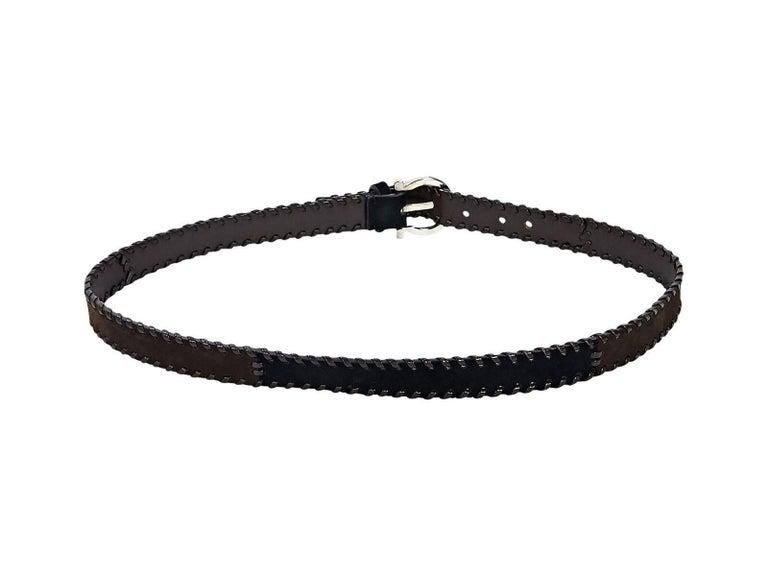 Product details:  Brown suede belt by Salvatore Ferragamo.  Leather whipstitched trim.  Adjustable buckle closure.  Silvertone hardware.  36