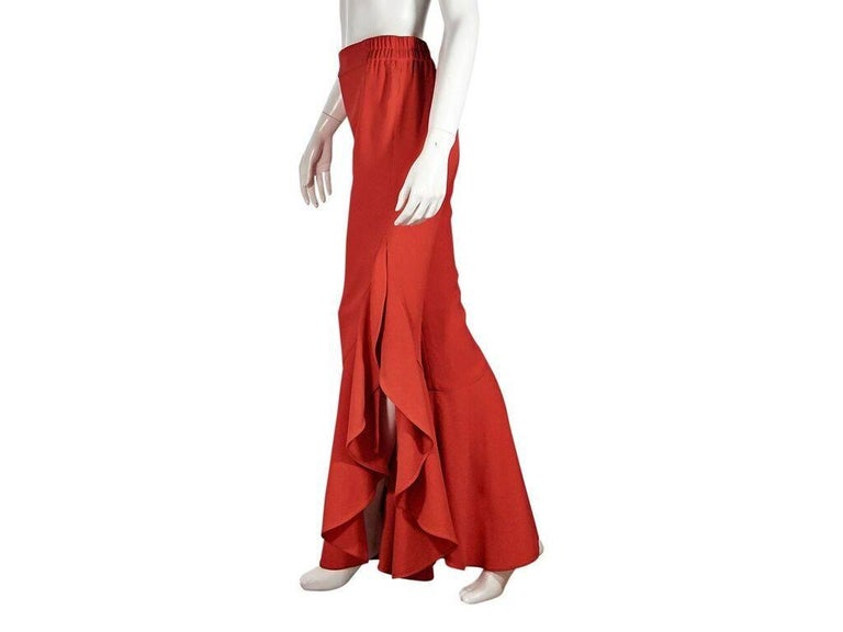 Product details:  Red-orange high-rise flared pants by Jonathan Simkhai x Carbon38.  Elasticized waist.  Cascading flared ruffles.  Side slits.  Pull-on style.  28