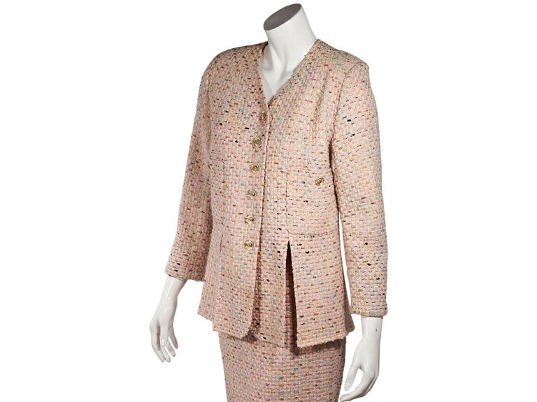Product details:  Multicolor tweed skirt suit set by Chanel.  V-neck.  Long sleeves.  Button-front closure.  Chest button patch pockets.  Vented hem.  Matching pencil skirt.  Concealed back zip closure.  Goldtone hardware.  Jacket:  36