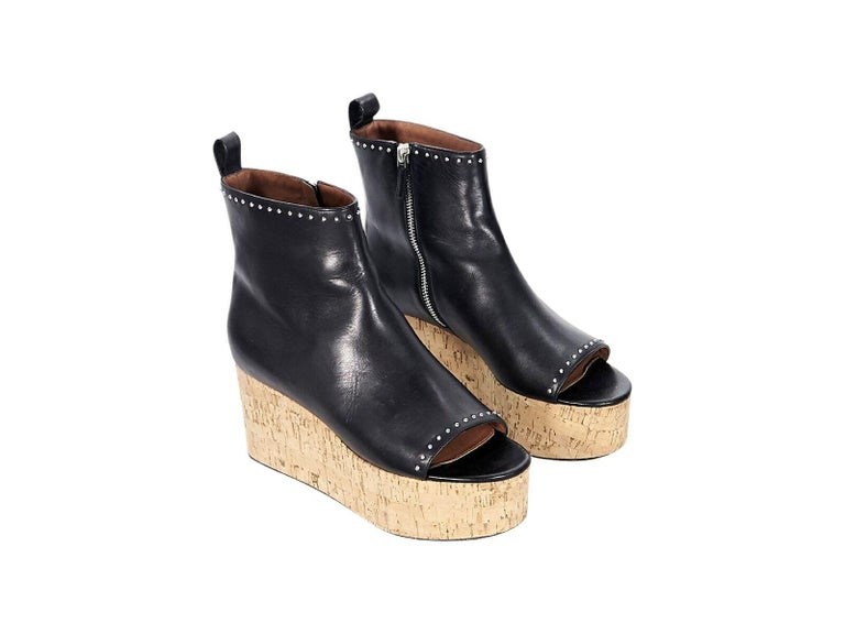 e092b1d72e18 Product details  Black leather wedge ankle boots by Givenchy. Accented with  studs. Inner
