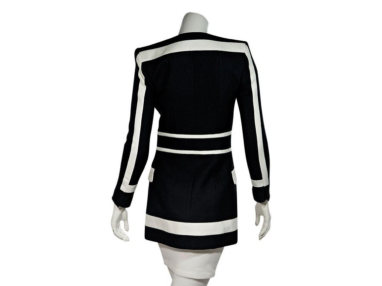Product details:  Black and white striped fitted blazer by Balmain.  Deep v-neckline.  Bracelet-length sleeves.  Concealed hook-front closure.  Waist flap pockets.  Label size FR 36.  32.5