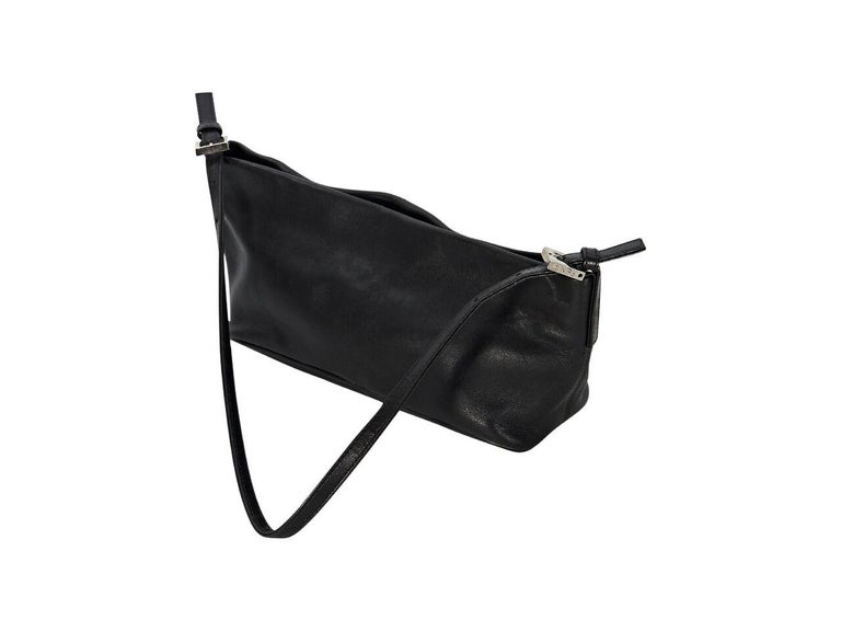 Product details:  Brown leather baguette shoulder bag by Fendi.  Single shoulder strap.  Top zip closure.  Lined interior with inner pocket.  Silvertone hardware.  11