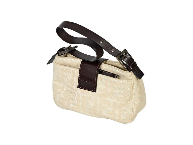 1f013abf2151 Product details  Cream zucca canvas shoulder bag by Fendi. Trimmed with  leather. Adjustable