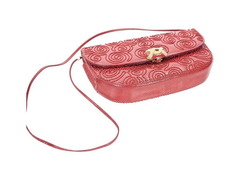 Product details:  Vintage red snake-embossed leather shoulder bag by Judith Leiber.  Tuck-away shoulder strap.  Front flap with clasp closure.  Lined interior with inner zip and slide pockets.  Goldtone hardware.  11.25