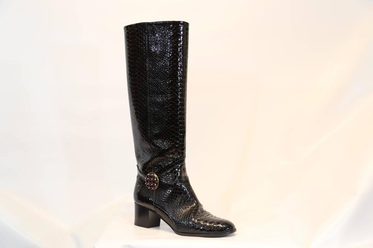 Chanel black python embossed patent leather boots. Jeweled detail on ankle. Knee high boots.