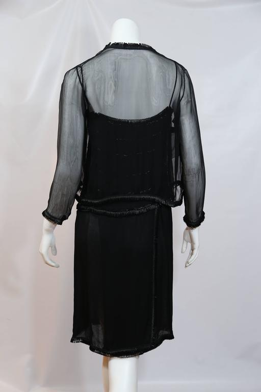 Chanel black sheer dress with beaded trim and detachable sheer shrug.
