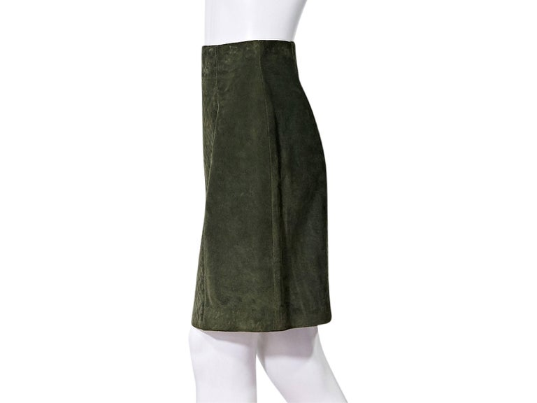 Product details:  Olive green suede pencil skirt by Chanel.  Quilted front panel.  Concealed back zip closure.  Double buttons at back hem.   Condition: Pre-owned. Very good. Est. Retail: $ 735.00