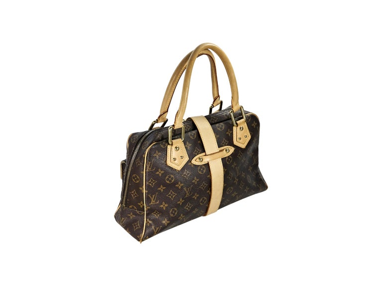 Product details:  Brown monogram coated canvas Manhattan GM bag by Louis Vuitton.  Trimmed with tan leather.  Dual carry handles.  Buckle strap over double top zip closure.  Lined interior with inner slide pocket.  Front push-lock flap pockets.