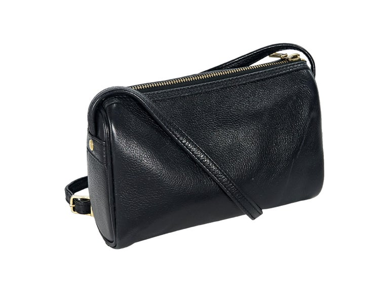 b47117d7818b Product details: Black leather crossbody bag by MCM. Accented with logo  plaque. Adjustable