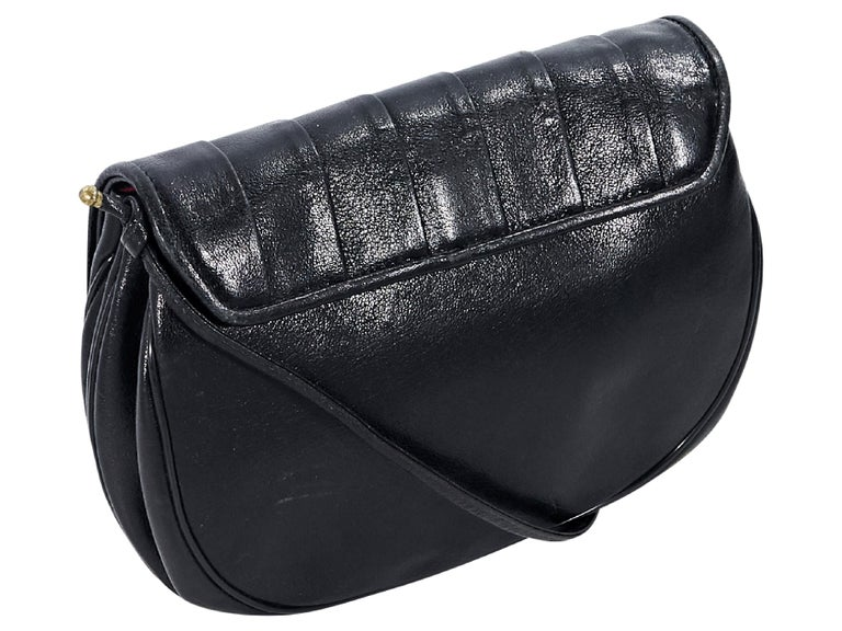 4941ac0b747 Product details: Vintage black leather small crossbody bag by Christian Dior.  Adjustable crossbody strap