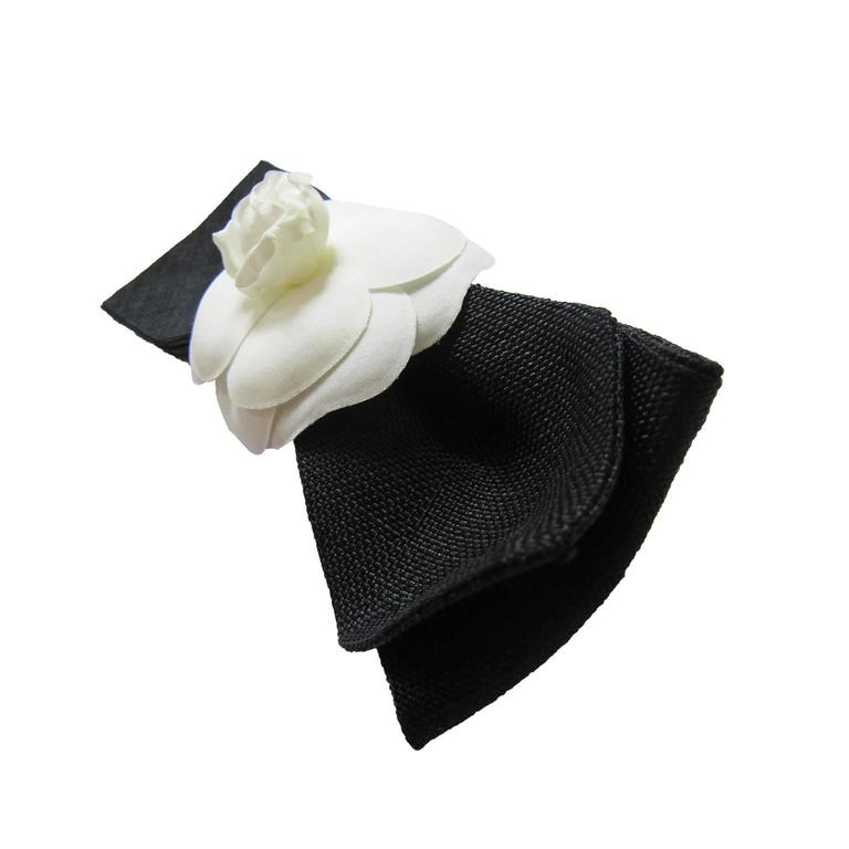 Chanel camellia black large woven bow with attached barrette. 