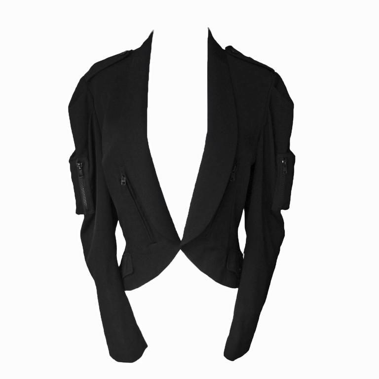 Yohji Yamamoto black blazer featuring zip pockets. This open front jacket has back longer hem detail, very interesting cuts from all sides. Estimated to be from the early 2000's. Original size 2 Measurements :  Shoulders : 42cm Sleeves 58