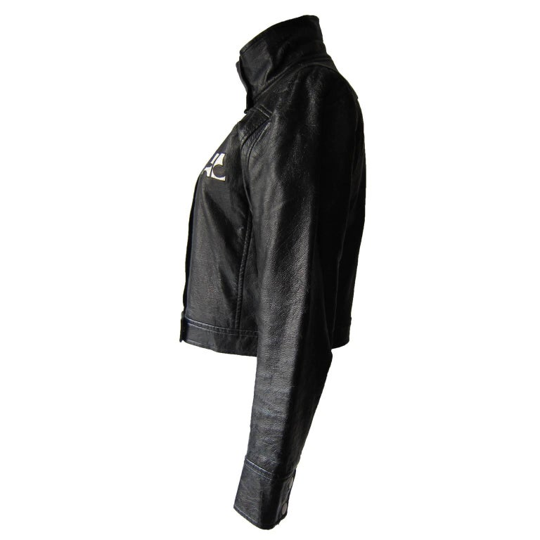Courreges signature black vinyl / faux leather jacket from 1980's.  Contrasted white snapped up button closure. French size : 40, 6 US