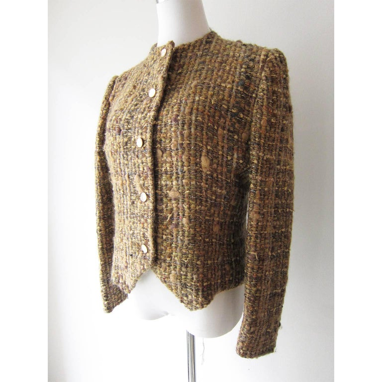 Chloe by Karl Lagerfeld beige and gold tone tweed jacket from circa 1980s. The buttons are made of mother-of-pearl. There is no size specification - please note the dimensions. It fit like Medium.  Measurements : Underarm : 95 cm Back Length : about
