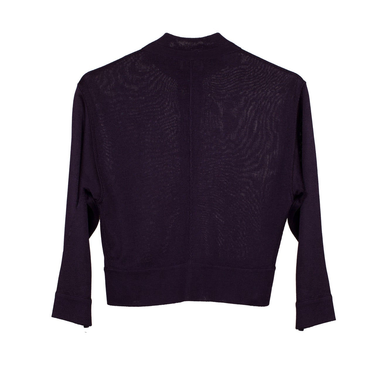Azzedine Alaia aubergine cardigan with center front button closure, dating to the early 1980's. 