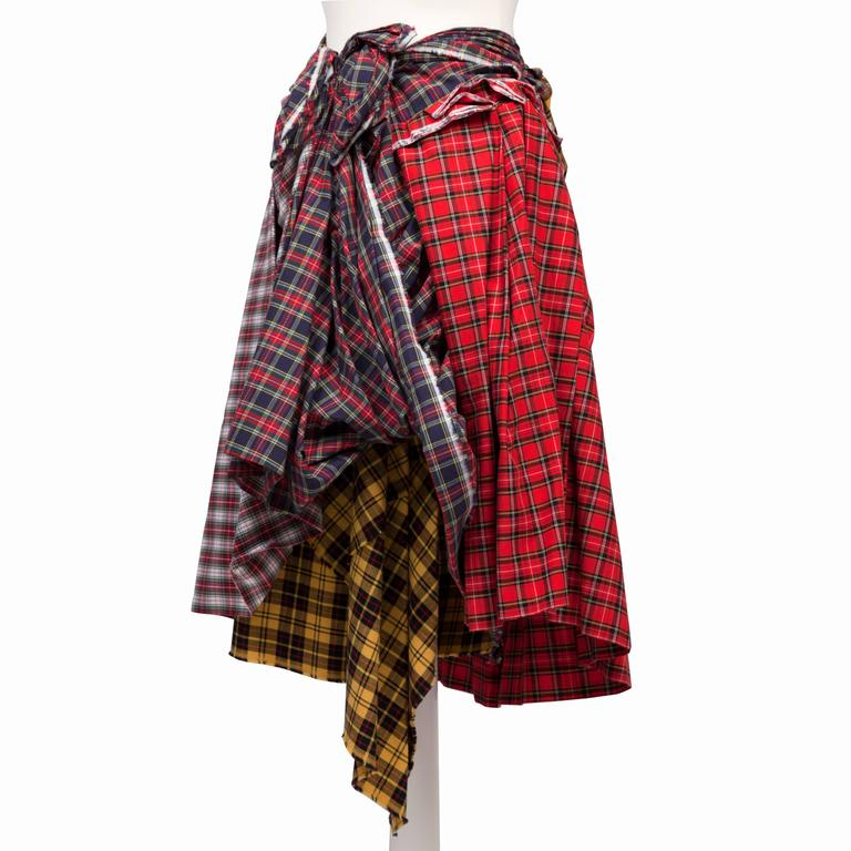 Comme des Garcons plaid skirt AD 2005.  Masterfully crafted piece with combination of tartan that made all sides have unique sculptural dimensions possible. Side zip opening. Original size Japan : L