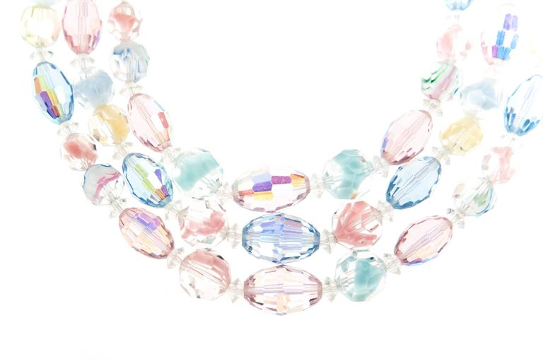 An exquisite triple strand Art glass necklace and matching clip on earrings by Laguna, c.1958.