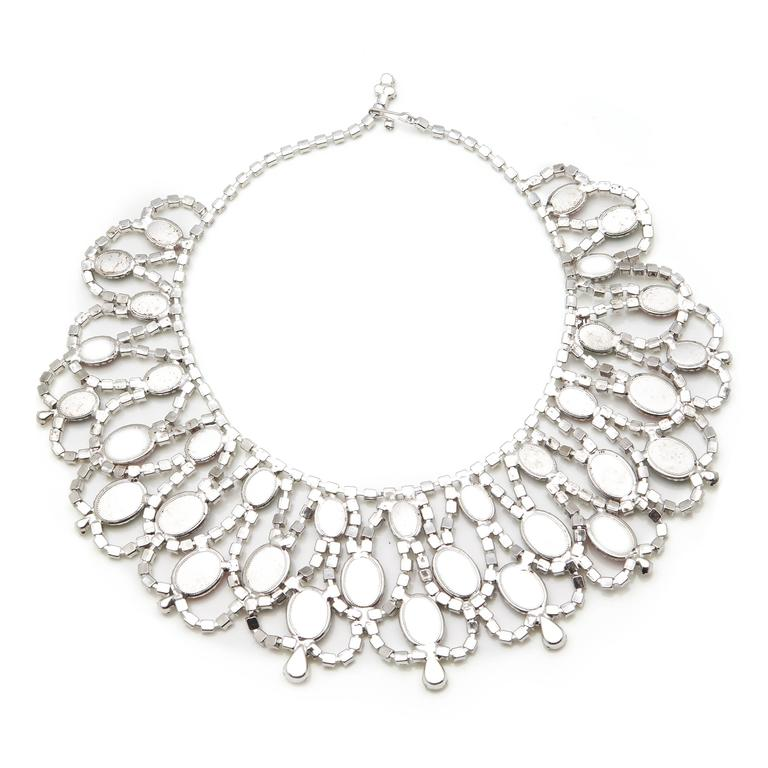 This an exceptional red carpet worthy piece it is unsigned but after exhaustive research has been attributed to Alice Caviness, based on signed examples of the same piece. The large Moghul inspired bib collar necklace is set with graduated oval
