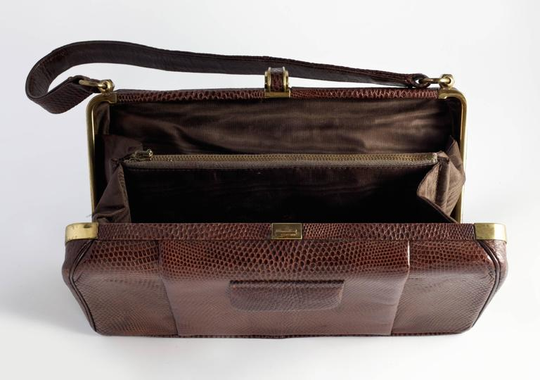 Fantastic post war 1940's box bag made by the highly collectable English brand Fassbender.  Made from Tan Lizard skin and lined with chocolate Brown silk, finished with gilt hardware, it comes complete with its original mirror.  The original