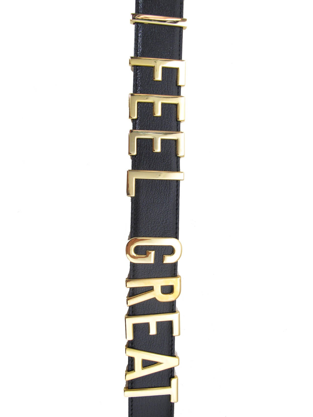 "Rare Moschino 1990s ""I FEEL GREAT"" Moveable Letters Waist Belt. Black leather belt with gold tone lettering.  Condition: Excellent, never worn, new in box with original tag.  Fits a 25 1/2"" , 26 1/2"" and largest 27"" waist."