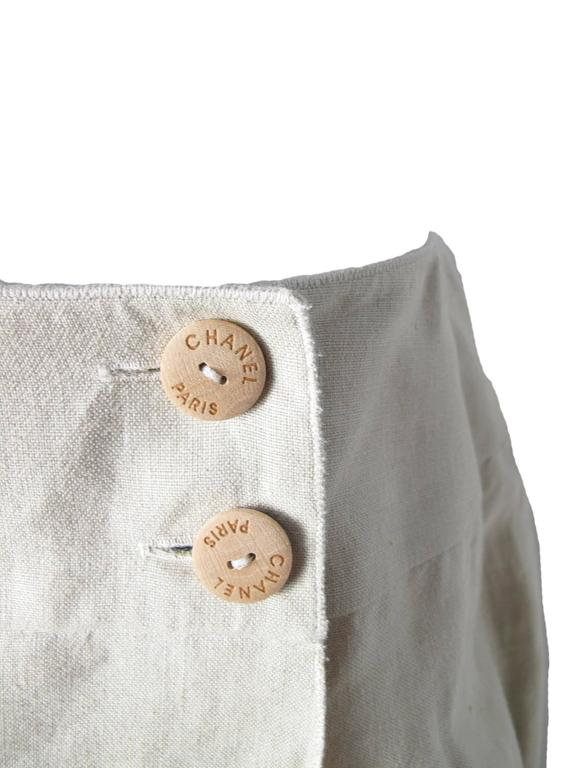 2000 Chanel beige linen wrap skirt.  Condition: Excellent.  Size 40/ US 6 - 8  We accept returns for refund, please see our terms.  We offer free ground shipping within the US.  Let us know if you have any questions.