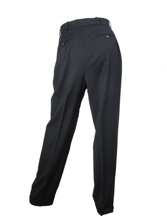 Chanel light weight black wool gabardine trouser; pleated front .  Condition: Excellent. Size 40/ US 6 - 8   We accept returns for refund, please see our terms.  We offer free ground shipping within the US.  Let us know if you have any questions.