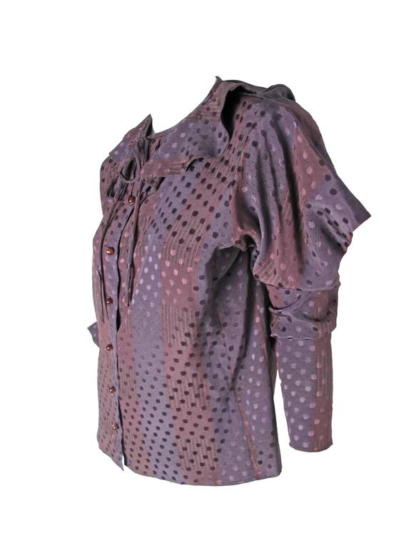 """1970s Ungaro purple silk blouse with stripe and polka dot print, ruffle at collar and tie.  Buttons down front, interesting sleeves.  Condition: Excellent. Size 14 / or current US Large 41"""" bust, 36"""" waist, 40"""" hips, 23 1/2"""" sleeve, 15 1/4"""""""