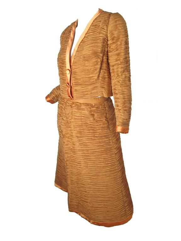 1960s Sybil Connolly Irish linen pleated jacket and skirt with satin trim.  Condition: Excellent. Size Medium