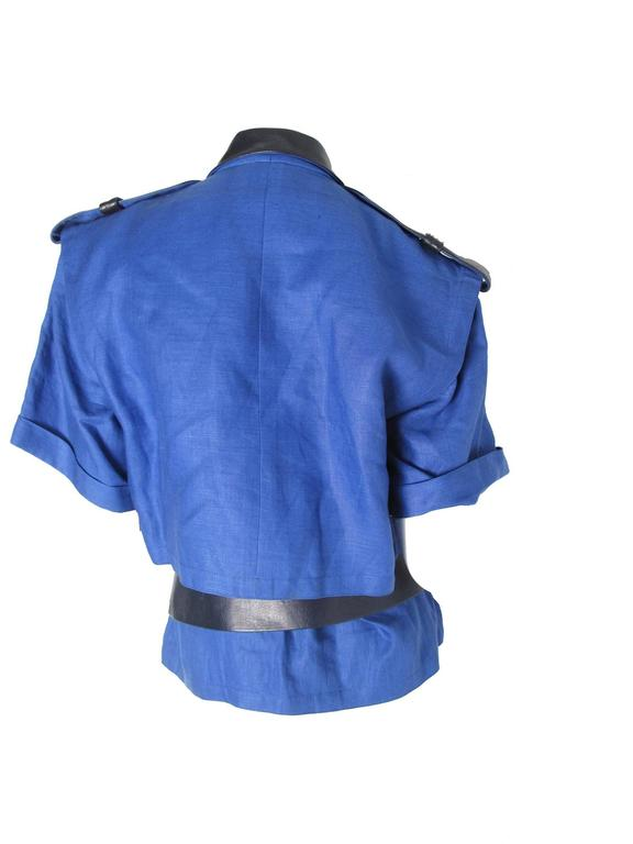 Berard Perris linen and leather police top. Two front pockets. Leather belt for waist, epaulettes, collar and pocket flaps. Condition: Very good.  Size 36/ US 4 - 6  40