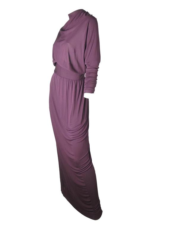 Gorgeous early 70s Givenchy deep purple viscose jersey evening gown with ruching at cuffs and down back.  Condition:  AS IS, some moth holes on front by neck and on some stitching is showing on back by zipper, see photo.  Zipper up back. Size 8