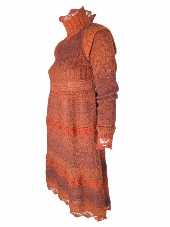 1990s Jean Paul Gaultier rust knit sweater dress with lace.  Interesting shoulder detail.  Condition: Excellent. Size XS  We accept returns for refund, please see our terms.  We offer free ground shipping within the US.  Let us know if you have