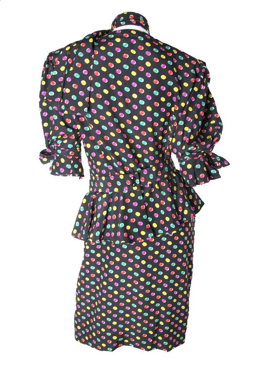 Ungaro black silk dress with colorful print.  Neck scarf and separate ruffle waist band, ties at sleeves.  Side pockets. Condition: Very good.  Size US 14.   38