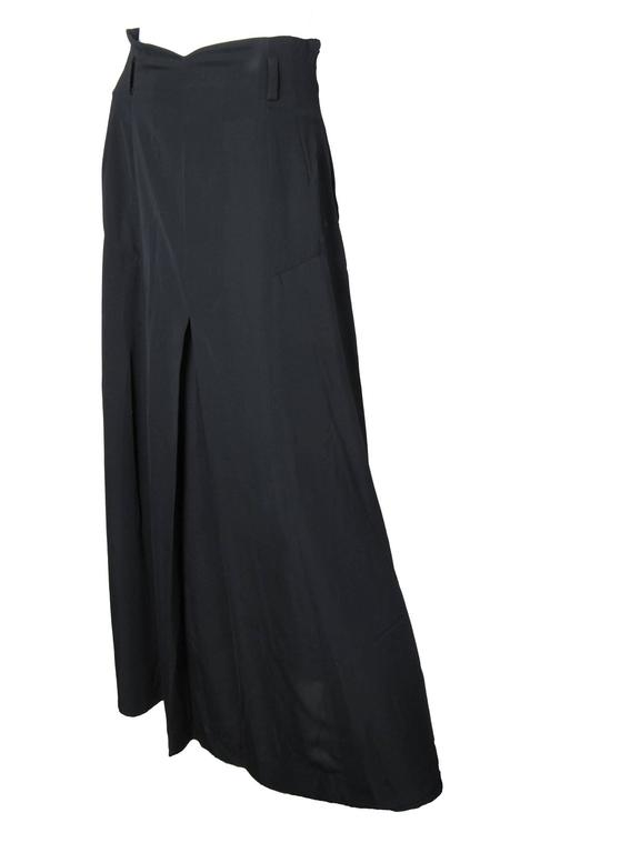 Matsuda black polyester skirt with pleating at back.   Condition: Very good, missing belt.  Made in Japan.  Size Medium