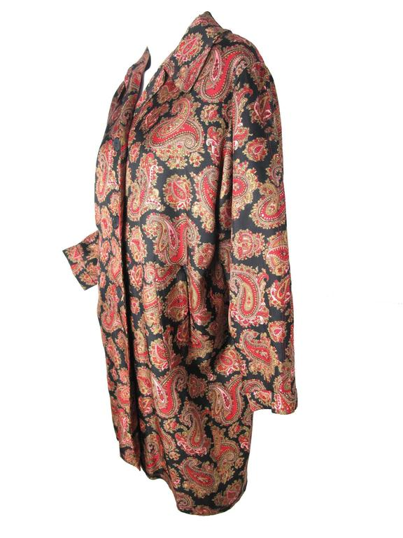 Jean Muir black, pink, red and tan silk paisley coat. Buttons down front, two side pockets.  Condition: Excellent. Size US 8 / UK 10