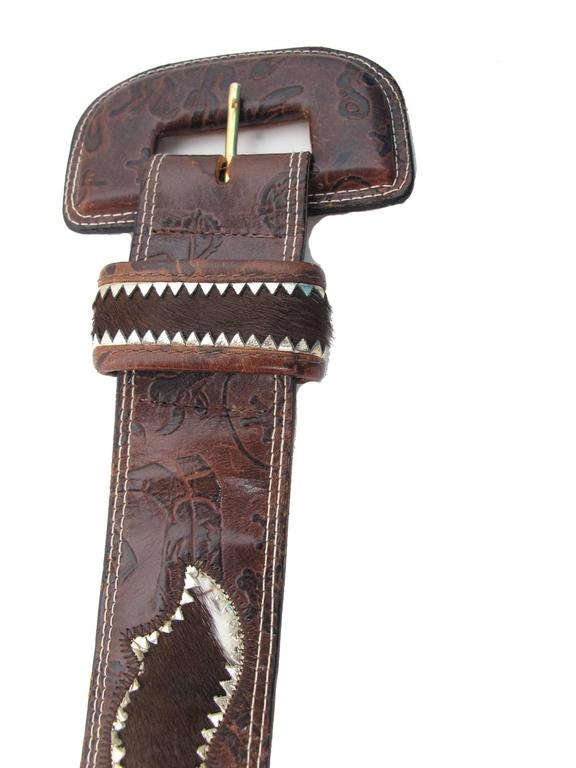 "Carlos Falchi brown leather stamped western theme belt with pony fur inserts.  Condition: Good, some wear . fits waist 27 ""- 29"".  2"" W. Size small