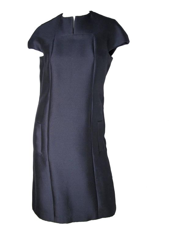 1960s Geoffrey Beene navy silk cocktail dress with side pockets. 